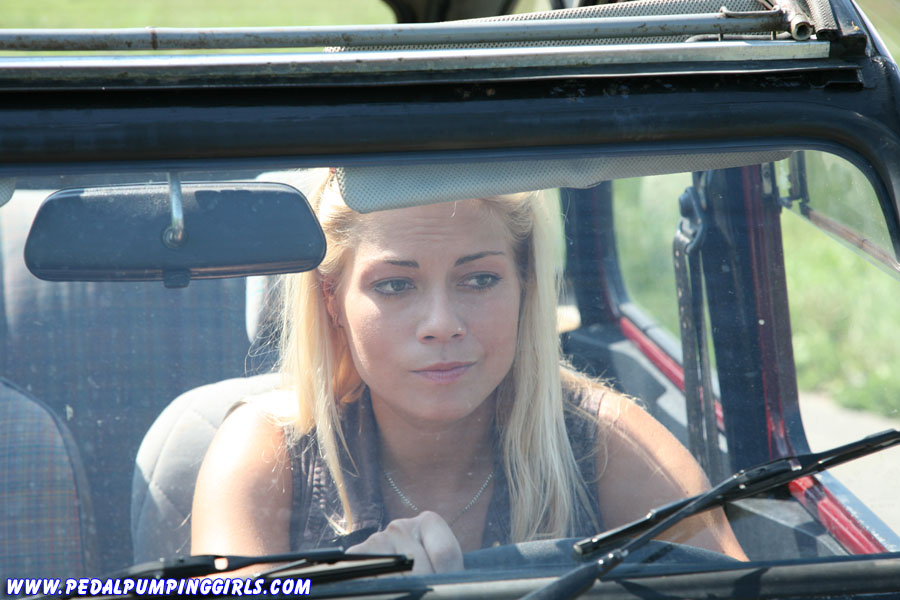 Pedal pumping girl driving a Citroen 2CV Ente